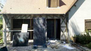 Extension ossature bois de plus de 10 m, avec façade vitré et ses BSO (Brise Soleil Orientable), pour ouvrir la maison sur le jardin en évitant la sur-chauffe, le tout, bien mieux isolé qu'une véranda classique à LA VILLE AUX CLERCS (41).
