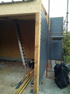 Réalisation d'un garage ossature bois avec lamellé collé, bardage bois, couverture tôle bac à BESSE SUR BRAYE (72).